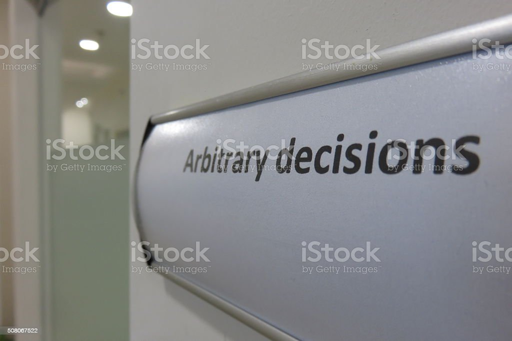 arbitrary Decisions office sign stock photo