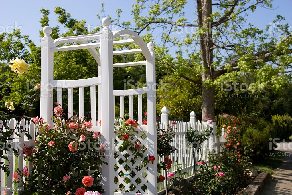 Arbor and Picket Fence royalty-free stock photo