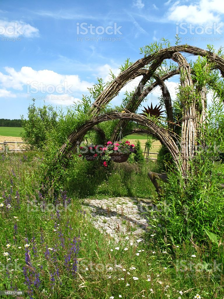 Arbor in herb garden stock photo