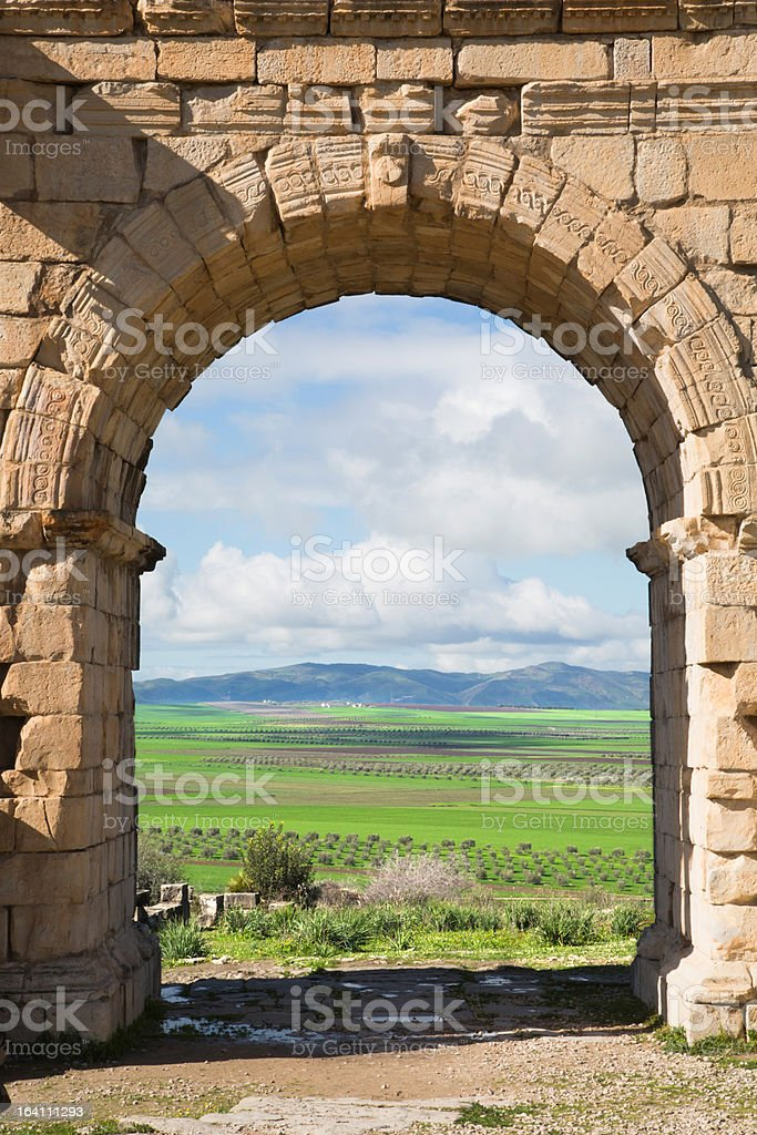 Arc at Volubilis, ancient roman city in Morocco royalty-free stock photo