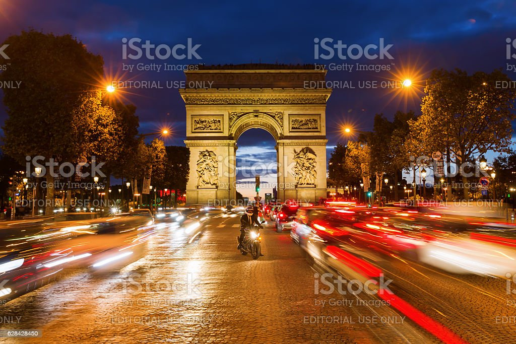 Arc de Triomphe at the Champs-Elysees in Paris at night stock photo
