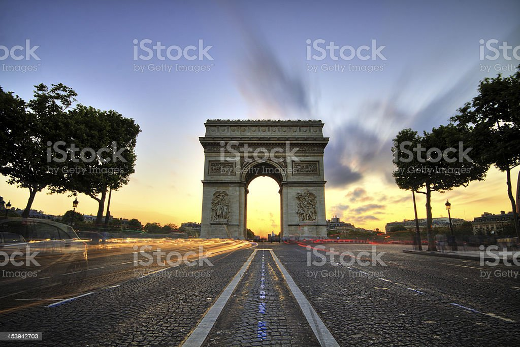 Arc de Triomphe at the sunset in Paris, France stock photo
