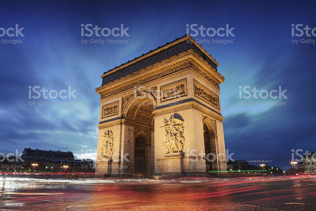 Arc de Triomphe in Paris at sunset with blurred cars stock photo