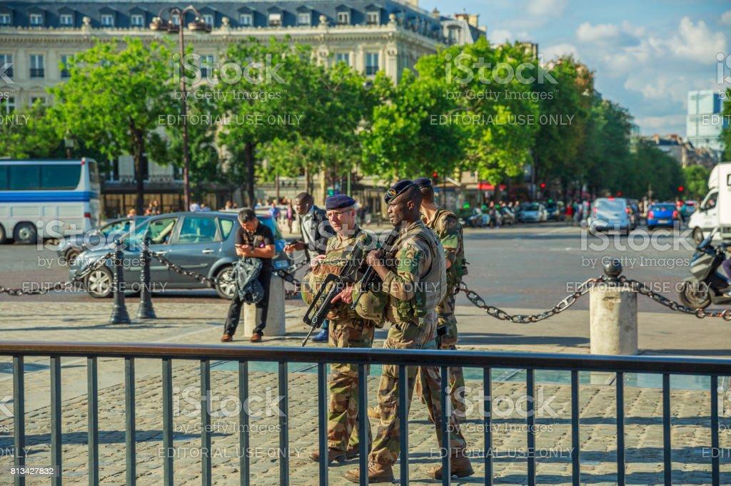 Arc de Triomphe soldiers stock photo