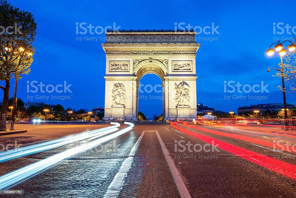 Arc de Triumph at night in Paris, France stock photo