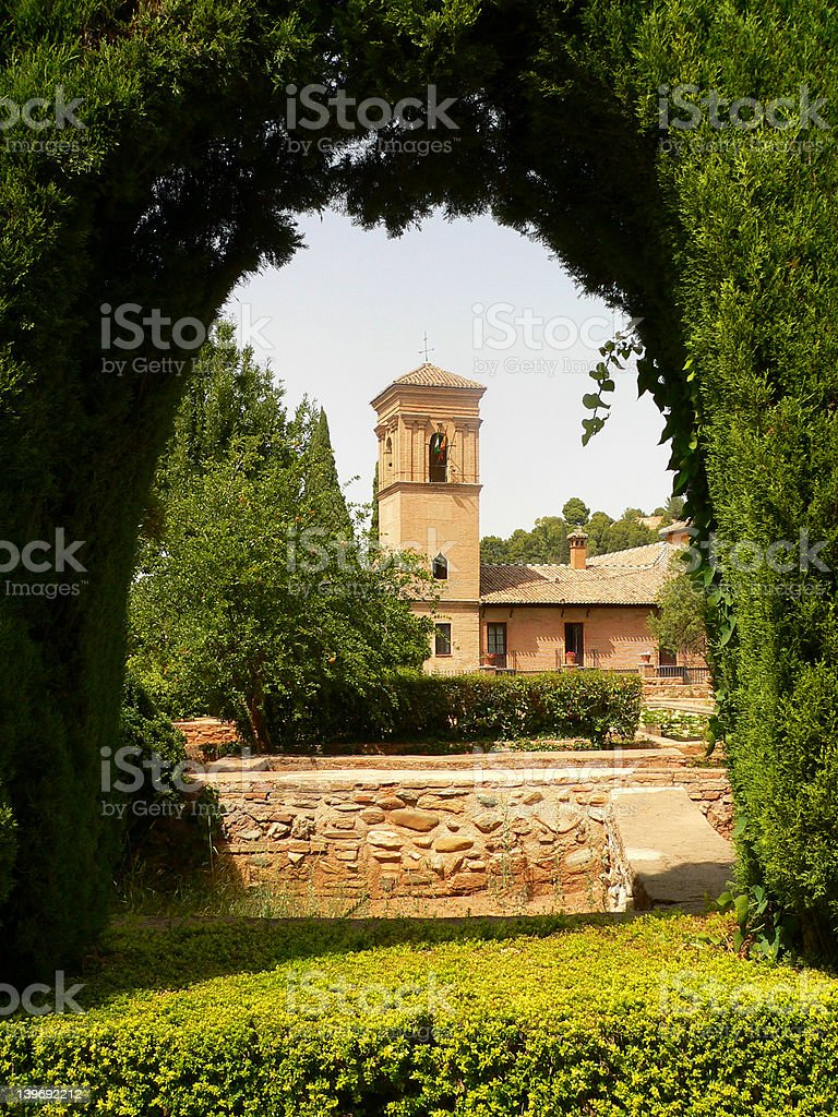 Arc of Alhambra garden stock photo