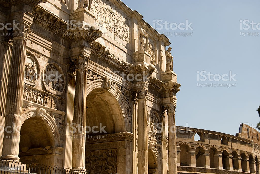 Arc Of Constantine with Colosseum stock photo