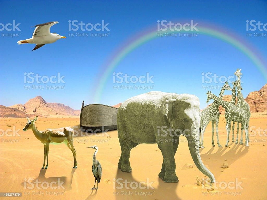 Arc of Noah in desert with rainbow stock photo
