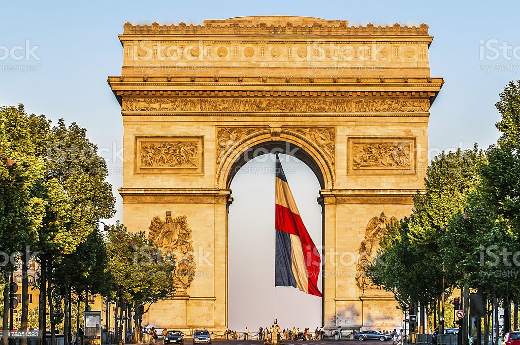arc of triumph with the french flag paris city France stock photo