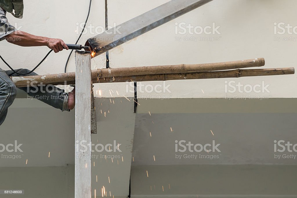 Arc welder cutting steel pipe with acetylene welding stock photo