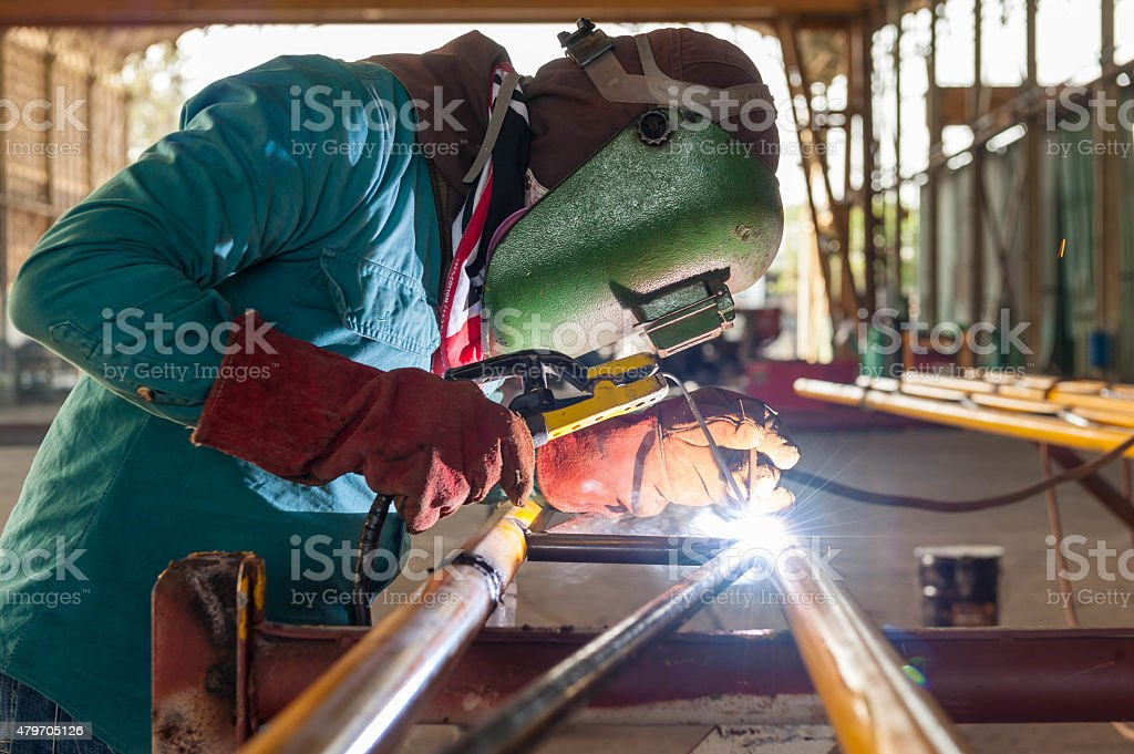Arc welder with welding sparks stock photo