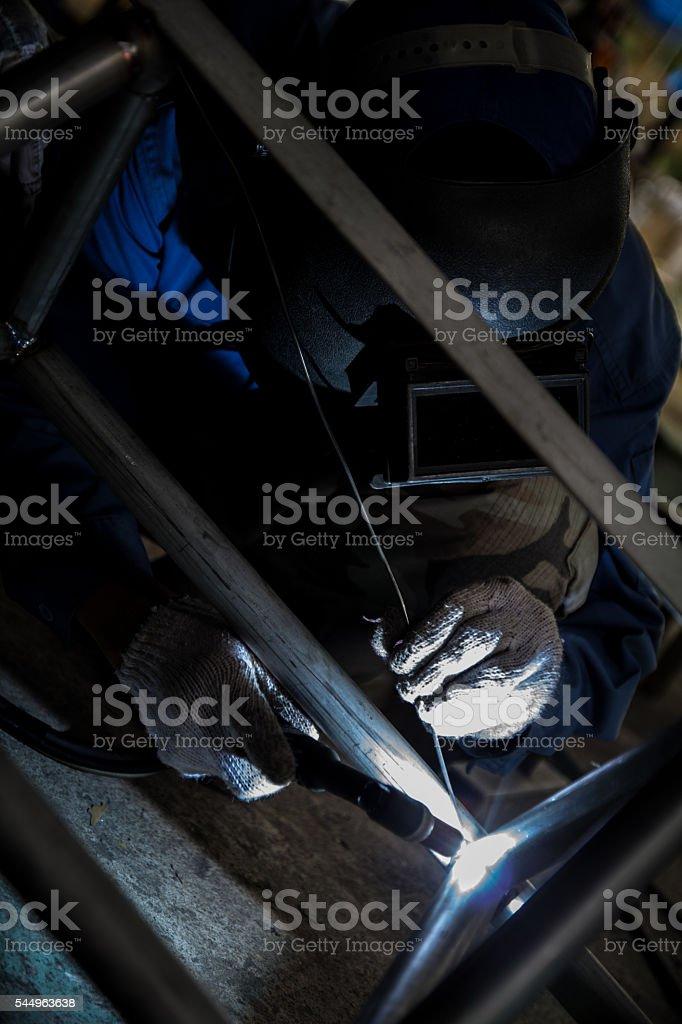 Arc welder with welding sparks stock photo