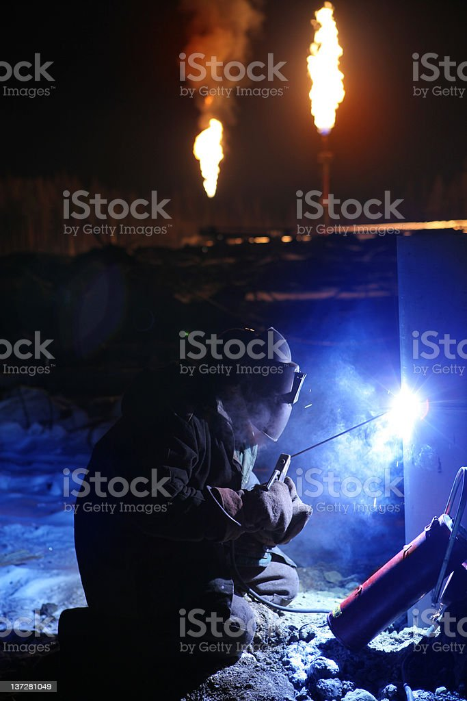 Arc Welder working on the Oil Field. stock photo