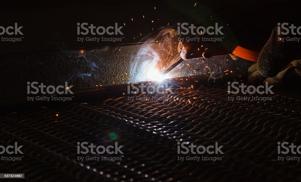 Arc welding and welding fumes stock photo