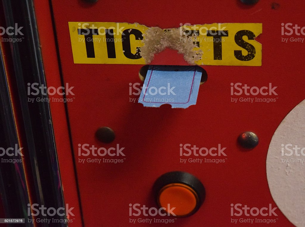 Arcade Game Dispensing Tickets Vintage Worn With Red Button stock photo