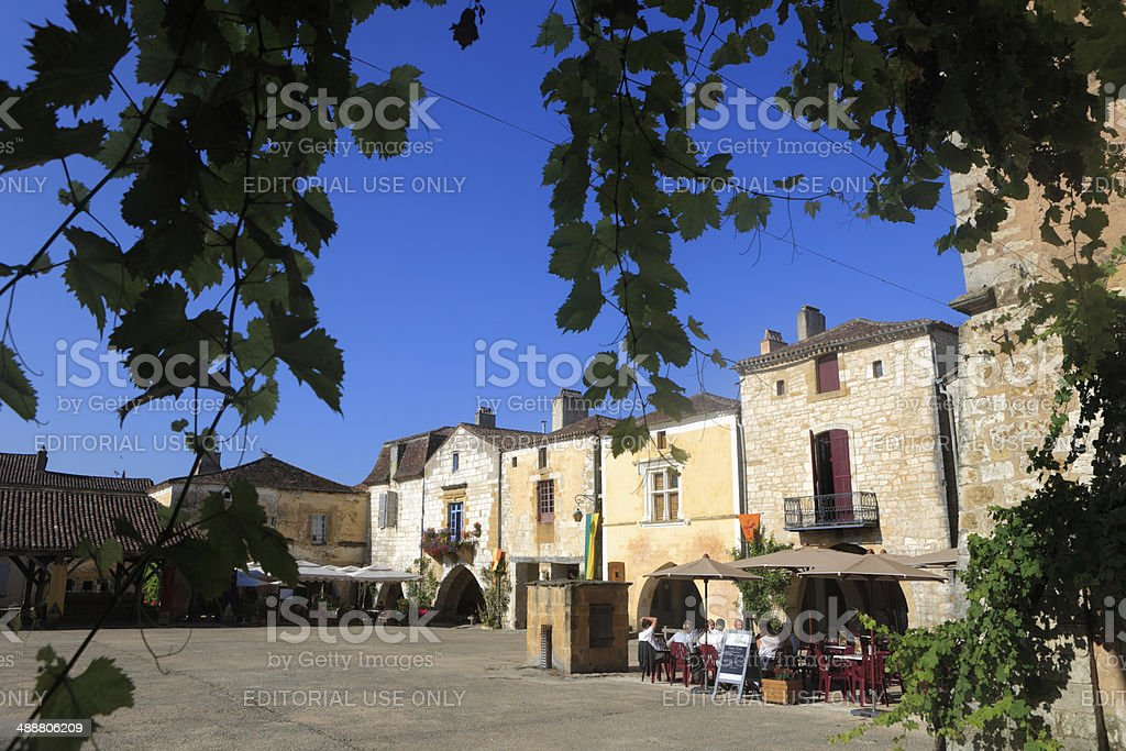 arcades and houses on the Place des Cornieres at Monpazier stock photo