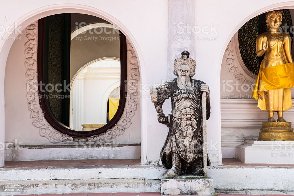 Arch and Chinese statue at Wat Phra Pathom Chedi stock photo