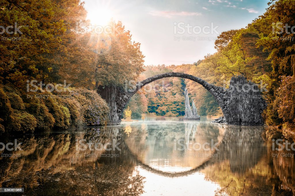 Arch Bridge (Rakotzbrucke) at Autumn stock photo