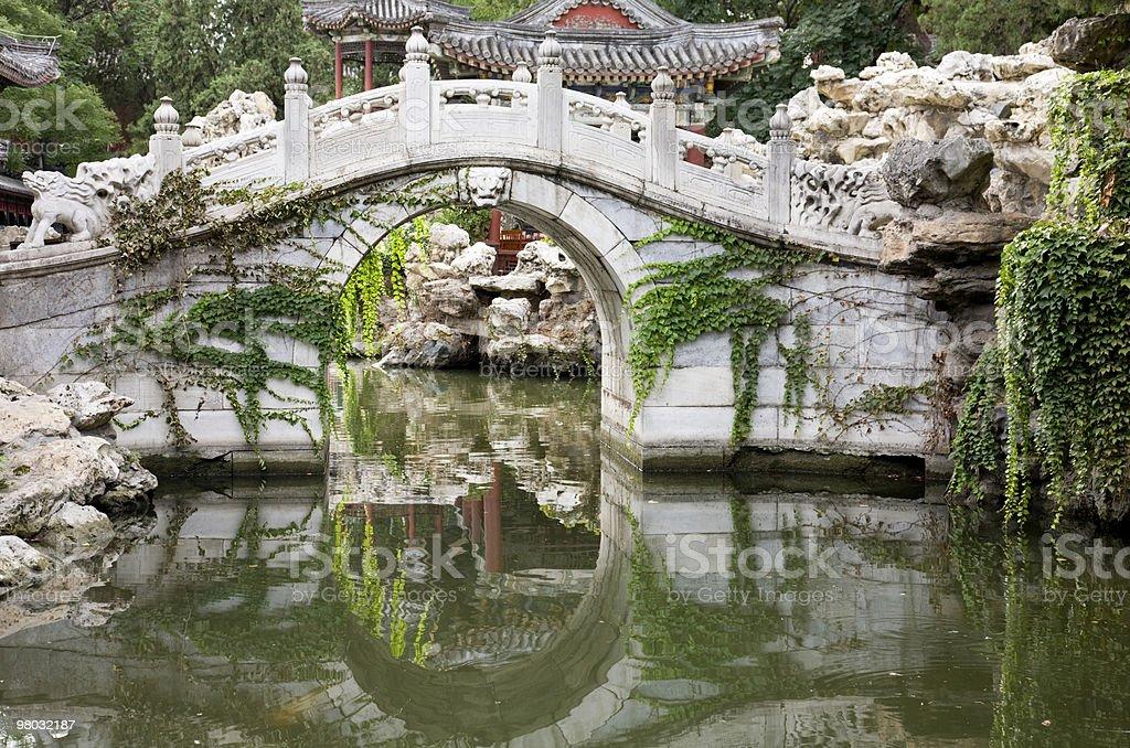 arch bridge in  formal garden royalty-free stock photo