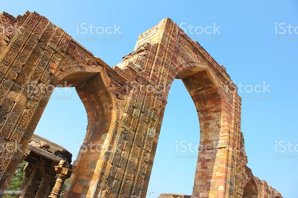 Arch gate for entrance at Qutab Minar with beautiful carving stock photo