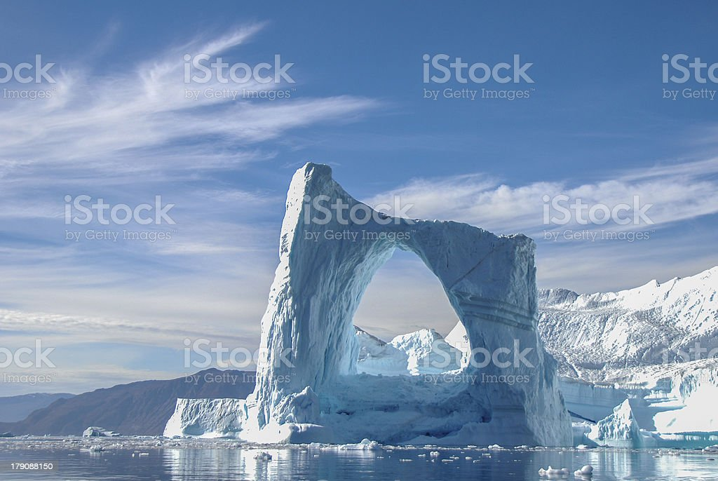 Arch iceberg in Greenland stock photo