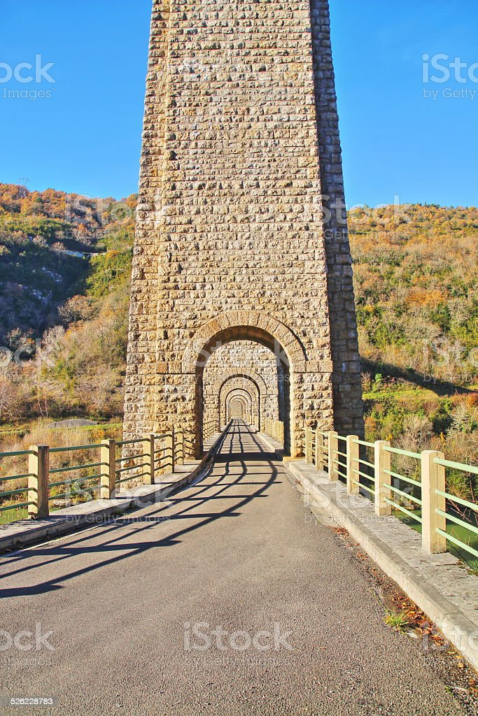 Arch in a row of stone French viaduct stock photo