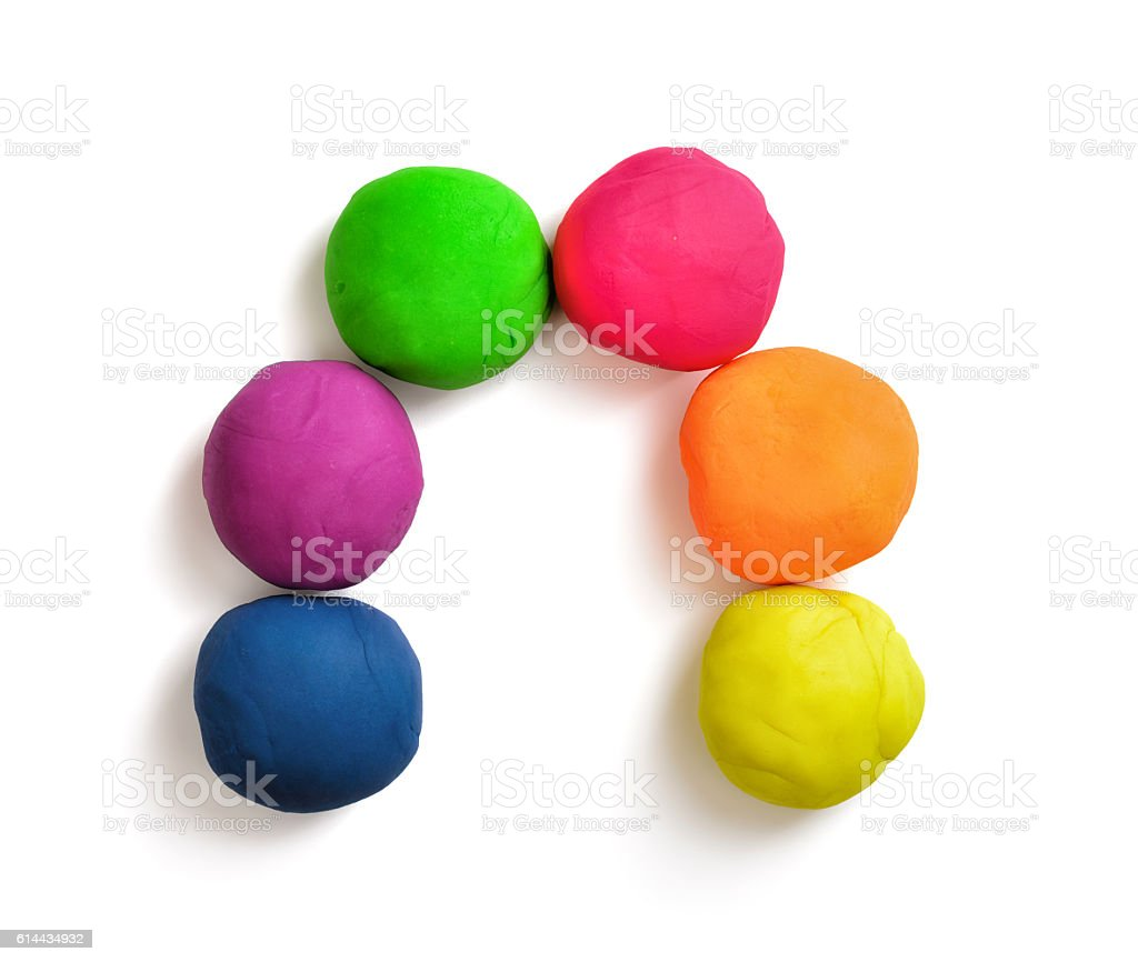 Arch made with colorful balls of modelling clay isolated on stock photo