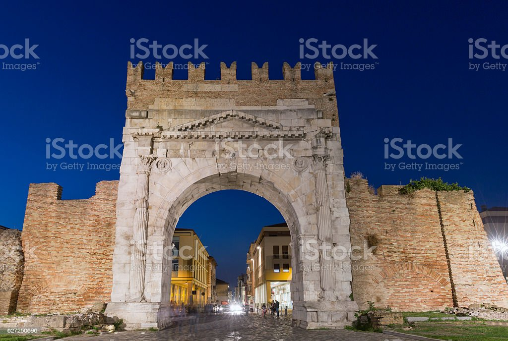 Arch of Augustus at night in Rimini, Italy stock photo