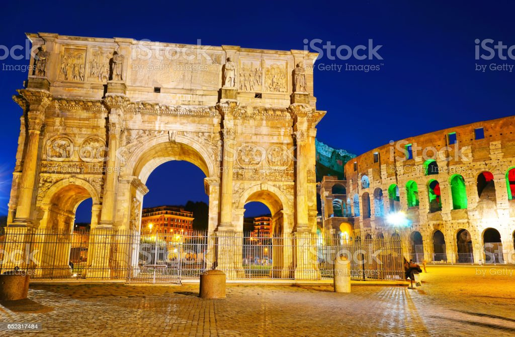 Arch of Constantine and Colosseum at night stock photo