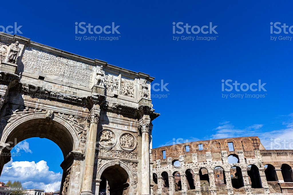 Arch of Constantine and Colosseum in Rome stock photo