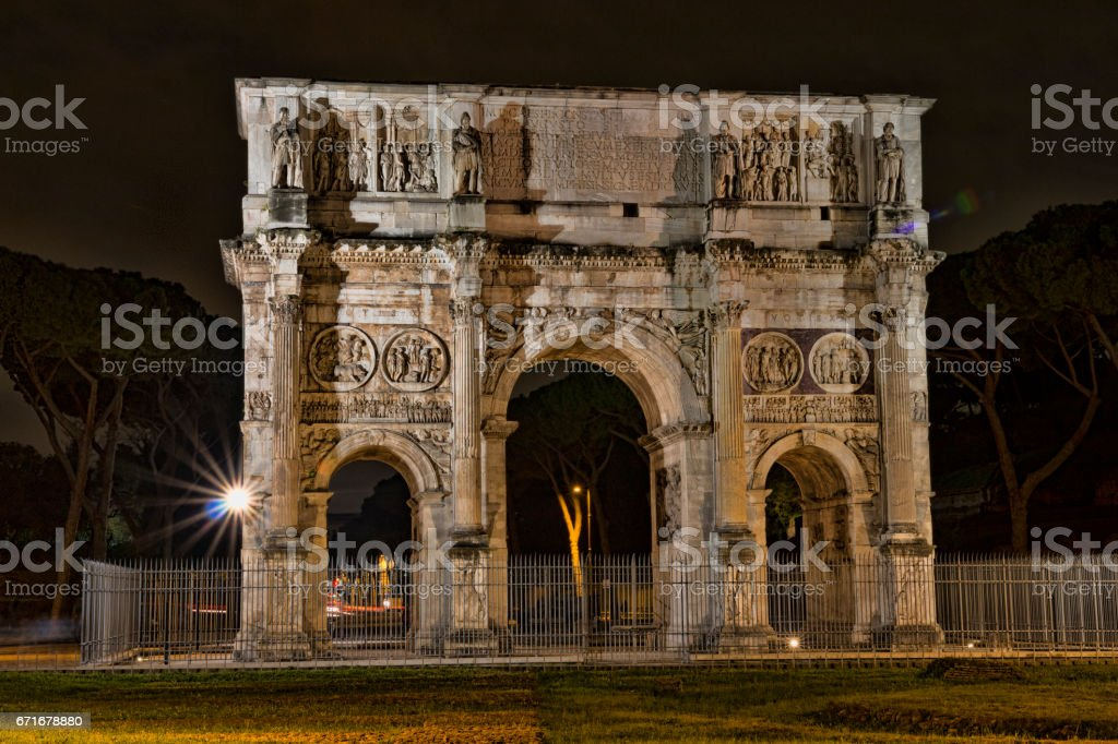 Arch of Constantine near the Colosseum at night. stock photo