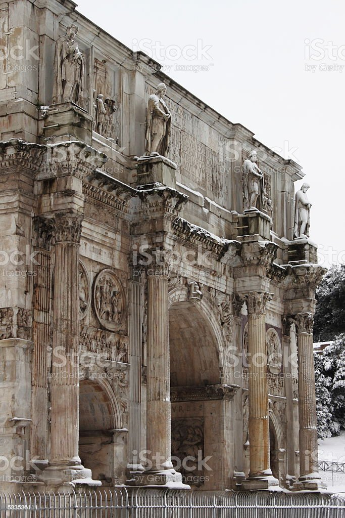 Arch of Constantine under snow stock photo