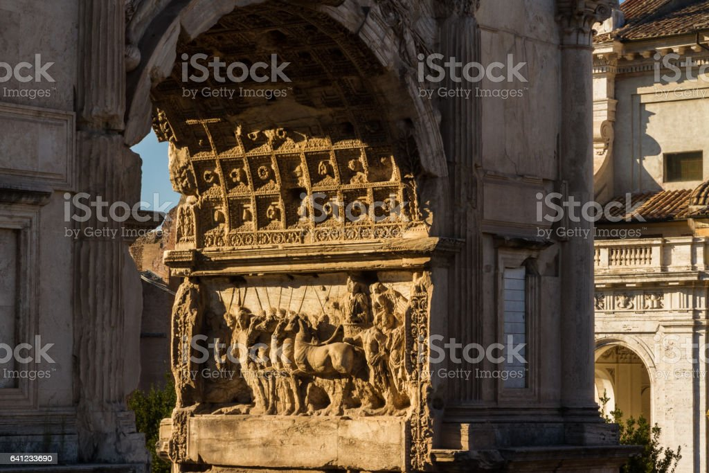 Arch of Titus relief in evening sun stock photo