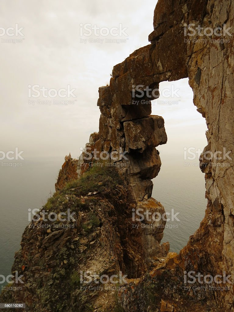 Arch rock near Aya bay at Lake Baikal. stock photo