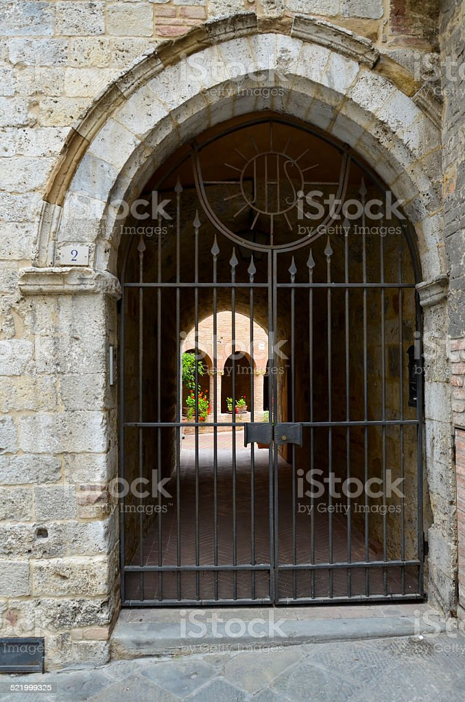Arch with gate to the court, Siena stock photo