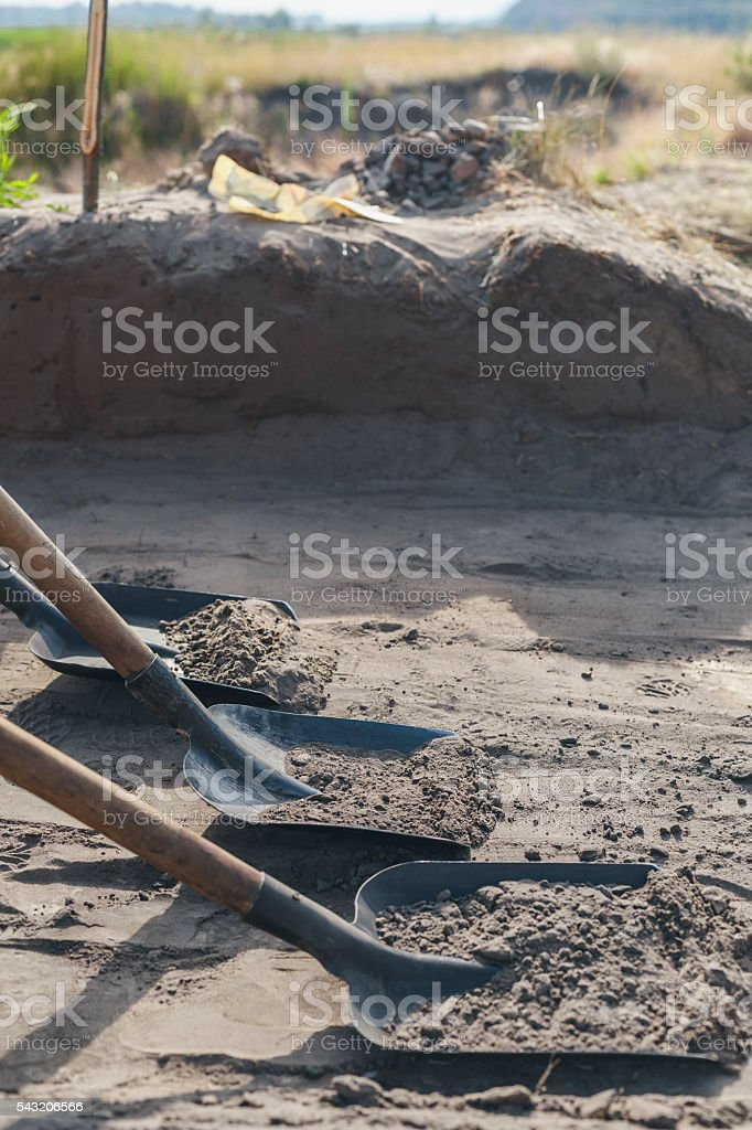 archaeological dig, with shovels removed thin layer of the earth stock photo