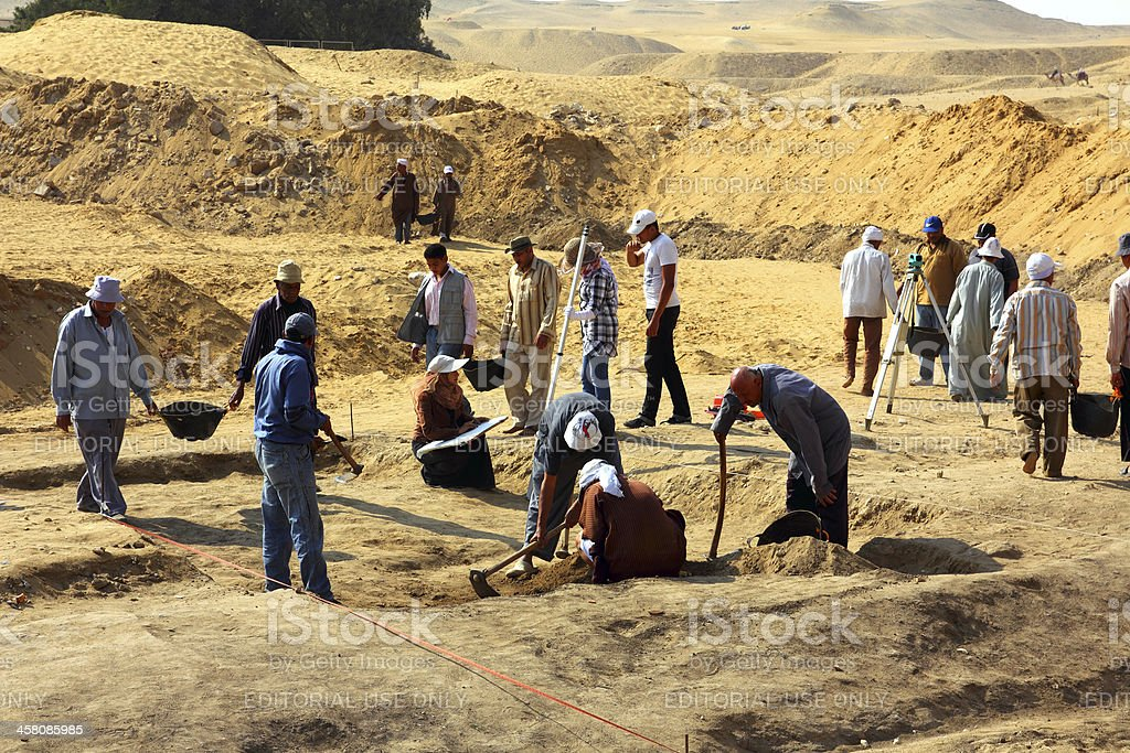 archaeological digging near statue of Sphinx in Egypt stock photo