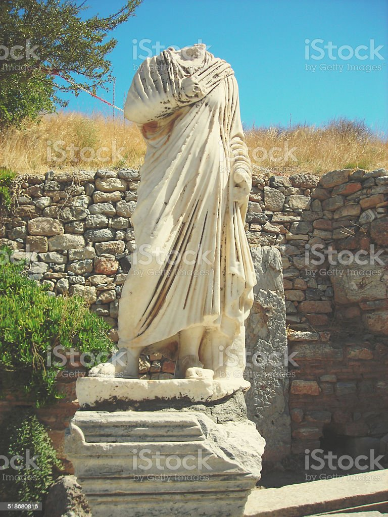 Archaeological remains at Ephesus, Turkey; white marble statue stock photo
