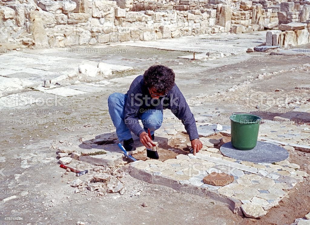 Archaeologist at work, Kourion, Cyprus. stock photo