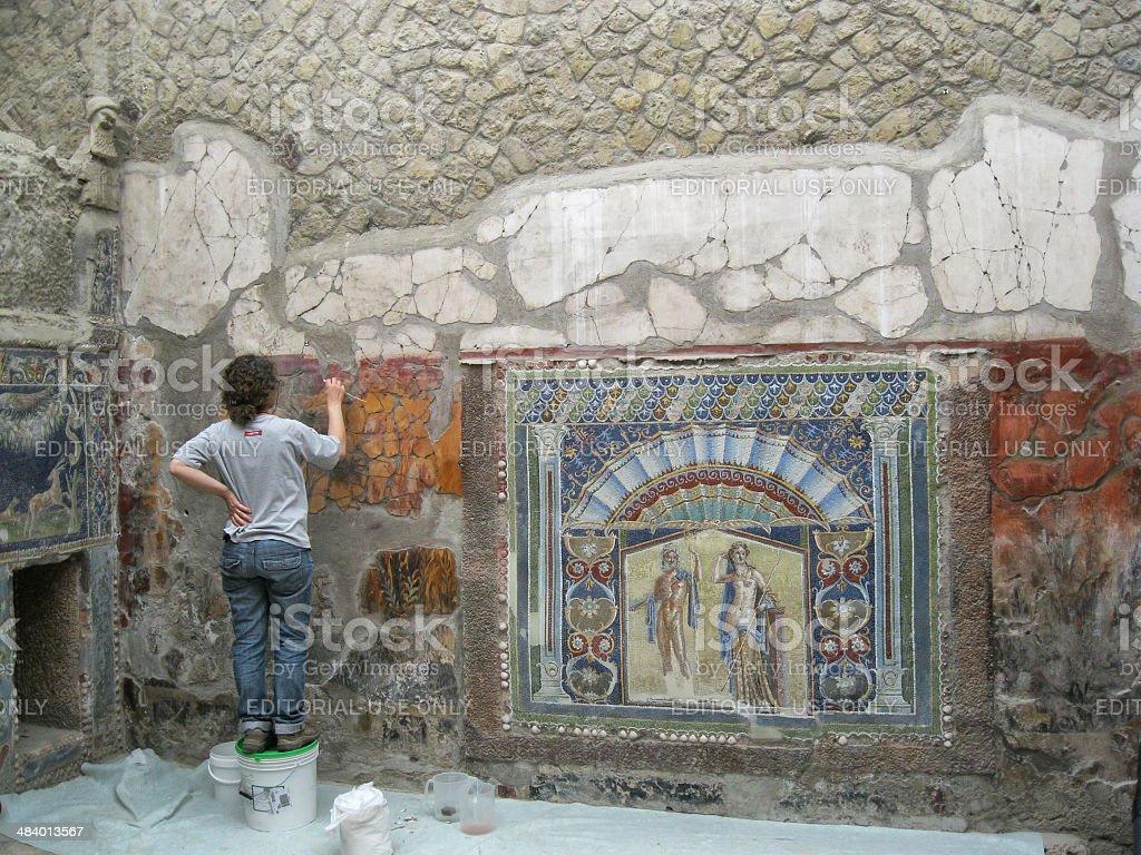 Archaeologist  Restoring Mosaic of Ercolano, Naples. stock photo