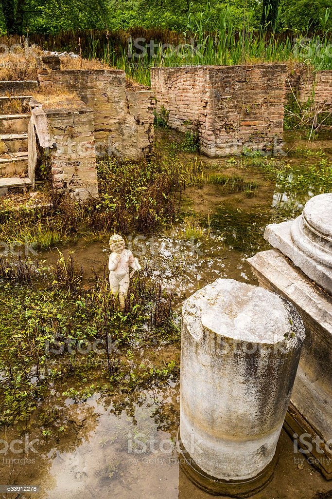 Archaic statue at ancient Dion Archeological Site in Greece stock photo