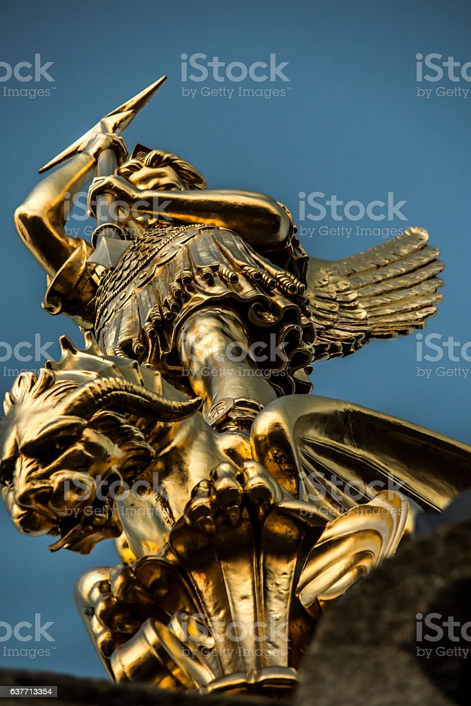 Archangel Michael fighting the dragon  in the town of Saint-Michel-Mont-Mercure stock photo