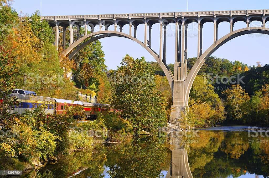 Arched bridge and passenger train stock photo