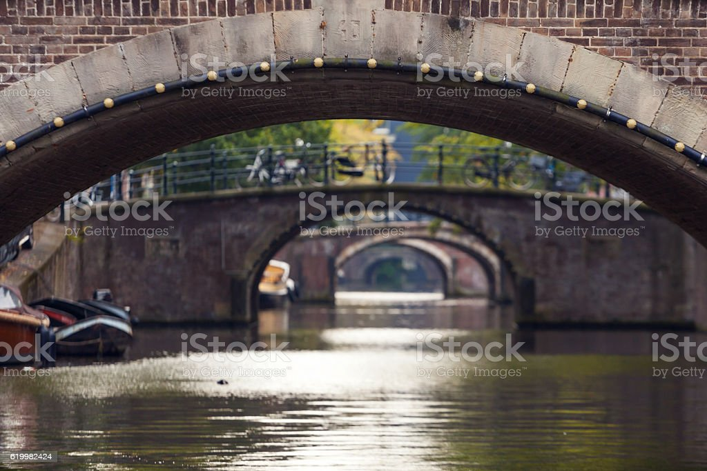 Arched bridges stretching into the distance in Amsterdam stock photo