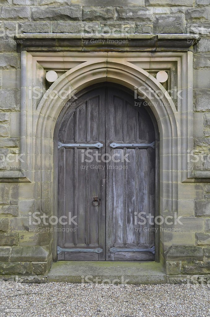 Arched doorway with oak wood door. stock photo