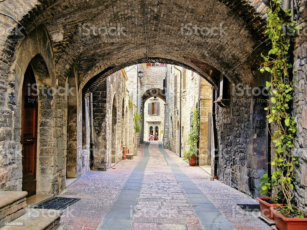 Arched medieval lane in Italy stock photo