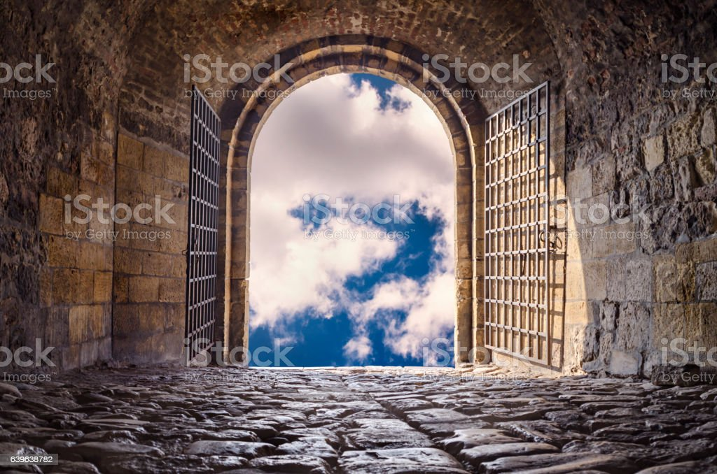 Arched passage open to heaven`s sky stock photo