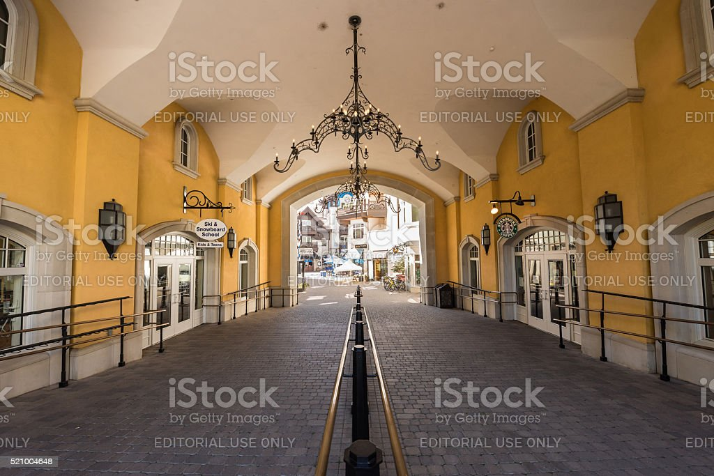 Arched Pathway with railing to the shopping area stock photo