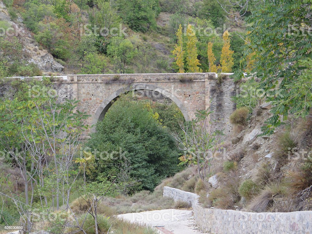 Arched road bridge stock photo