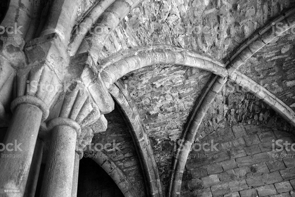 Arched roof of a ruined Abbey - MONO royalty-free stock photo